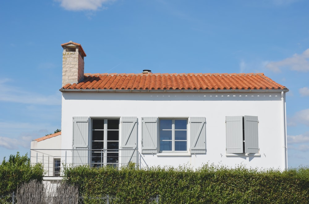 white and orange painted house