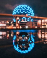 selective focus photography of waterball with ball monument