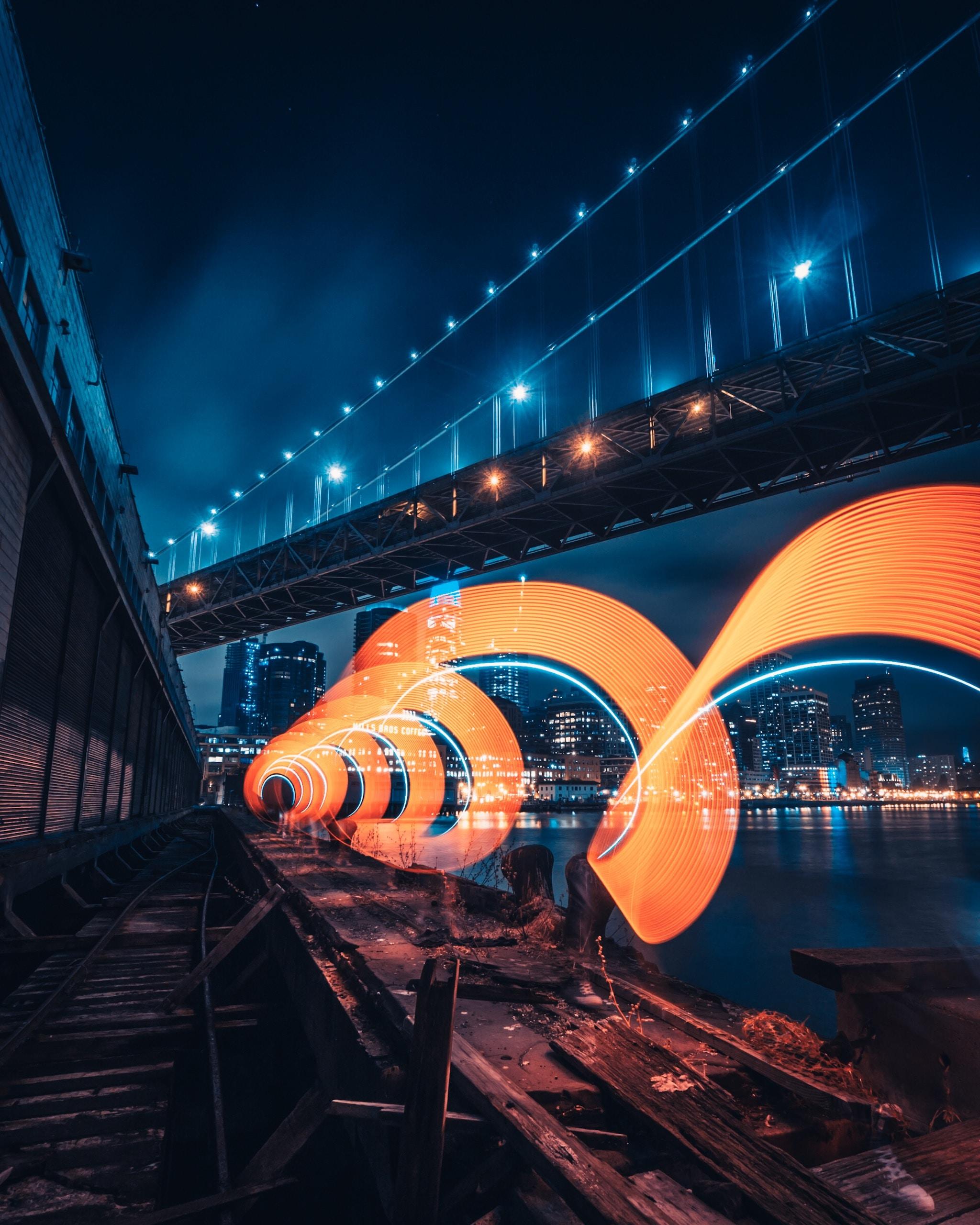 metal bridge near building during night time