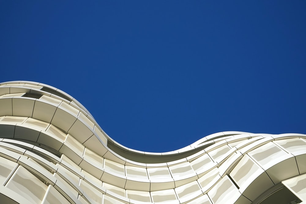 low-angle photo of curve building