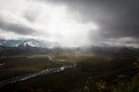 mountain range under white clouds during daytime