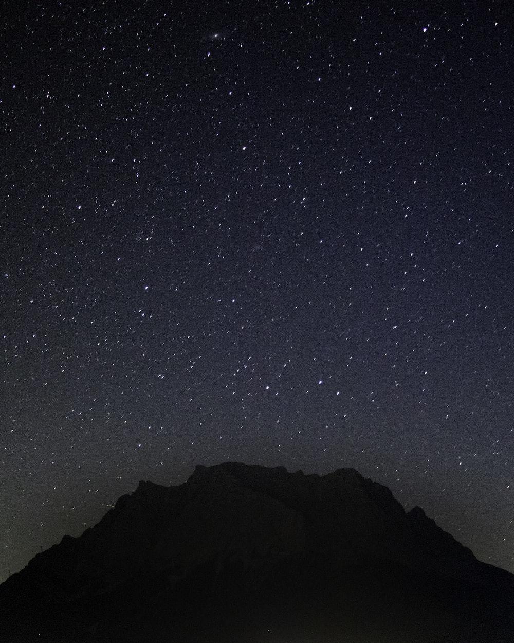 view of peak of mountains during stargazing phenomenon