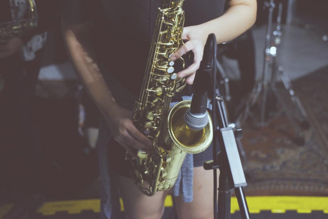 woman playing sax at a tiny bar