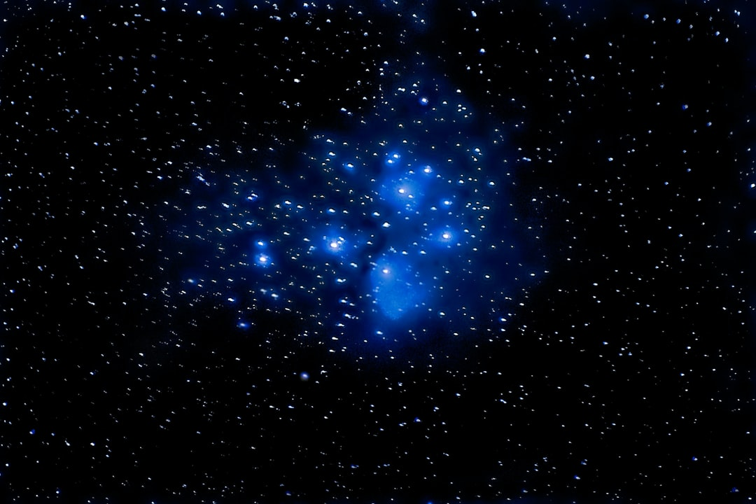 The Pleiades cluster of stars covers an area about four times the apparent size of the full moon. This is a reflection nebula, where the light  from hot blue stars is reflected by interstellar dust. The two bright stars on the left side of the image are Atlas and Pleione, the parents in Greek mythology of seven sisters forming the nine brightest stars in this cluster. The name Pleiades indicates the sisters are daughters of Pleione. The cluster is 440 light years from the solar system. This image consists of a stack of 23 exposures of 20 seconds each using the Pentax Astrotracer function.