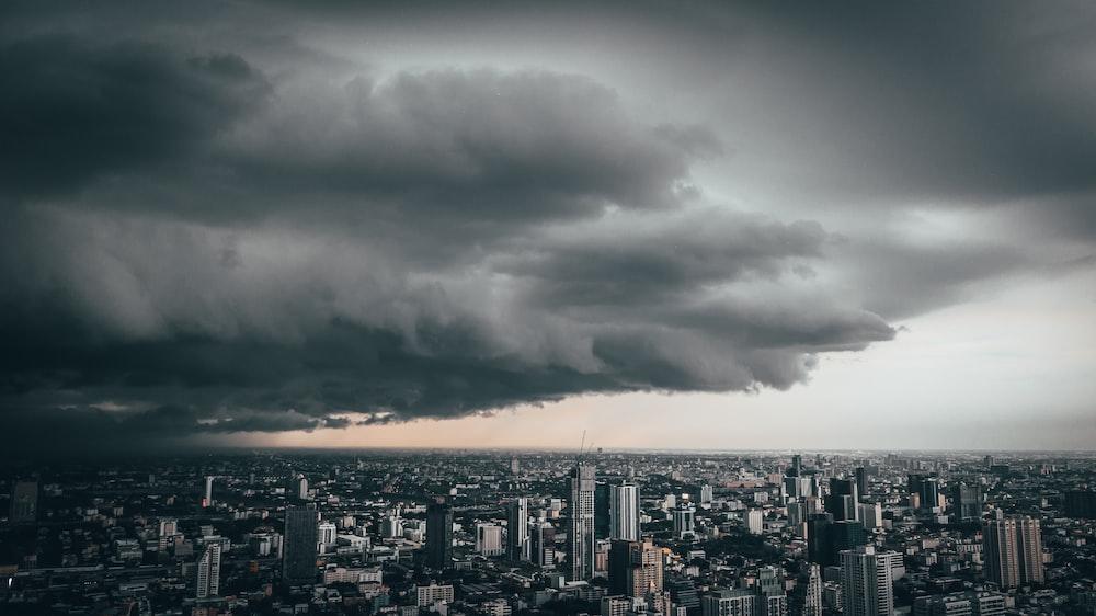 cumulonimbus clouds over city buildings