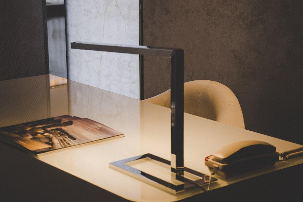 gray home telephoto on desk