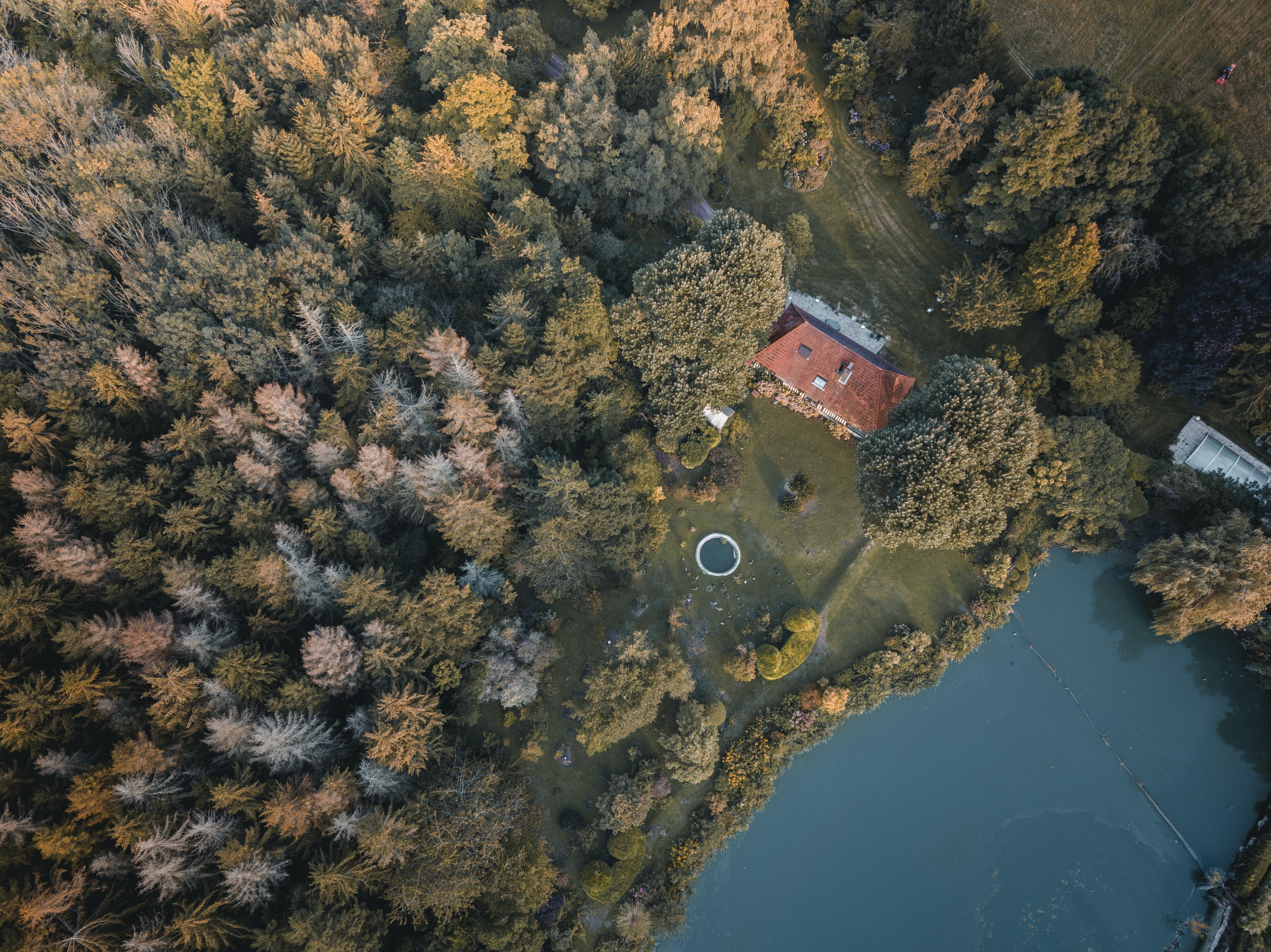 aerial photography on brown mansion near body of water