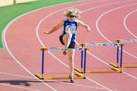 woman running on brown field
