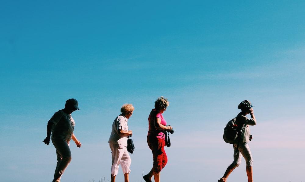 four people walking
