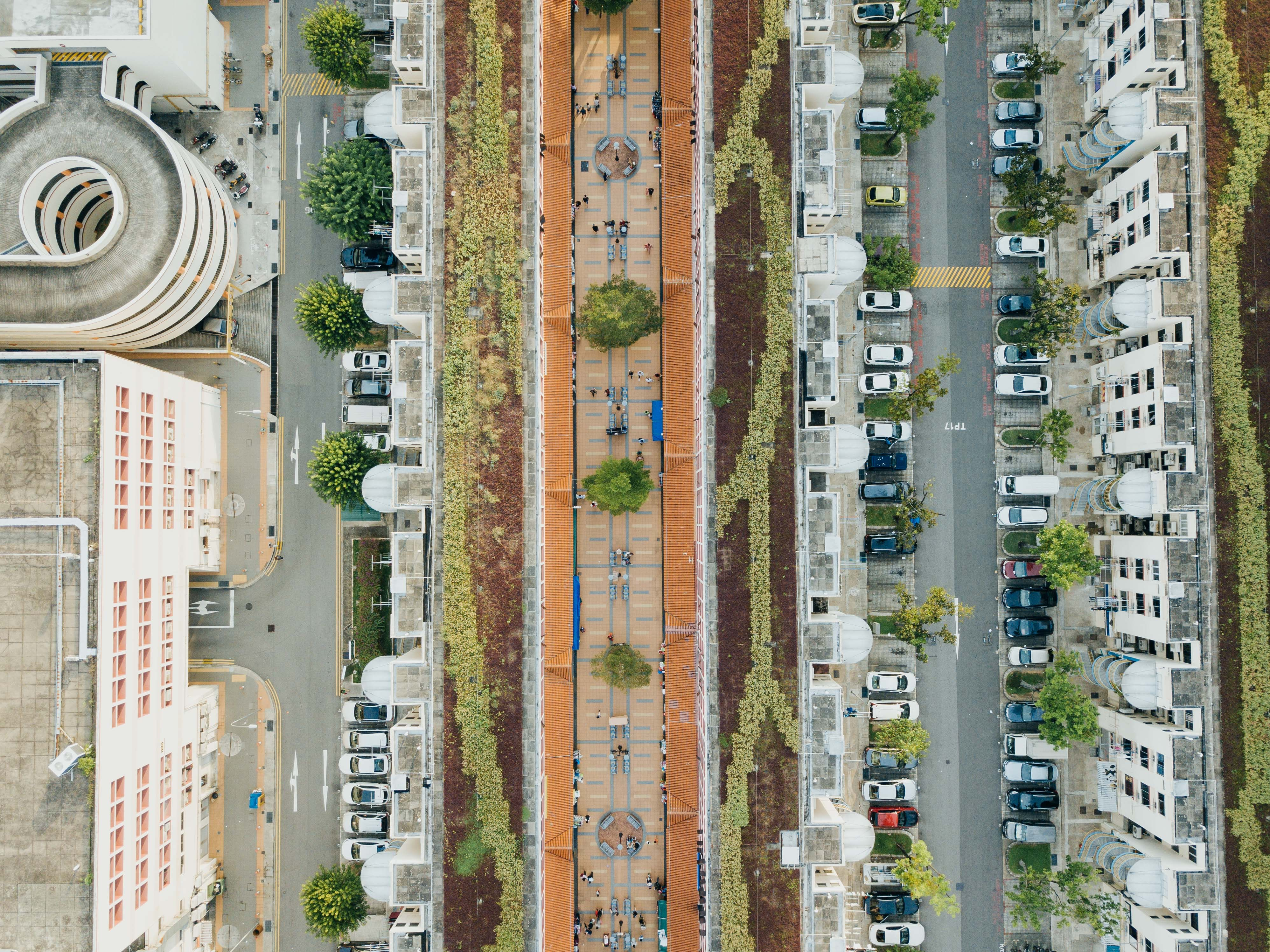 aerial view photography of road between highrise buildings