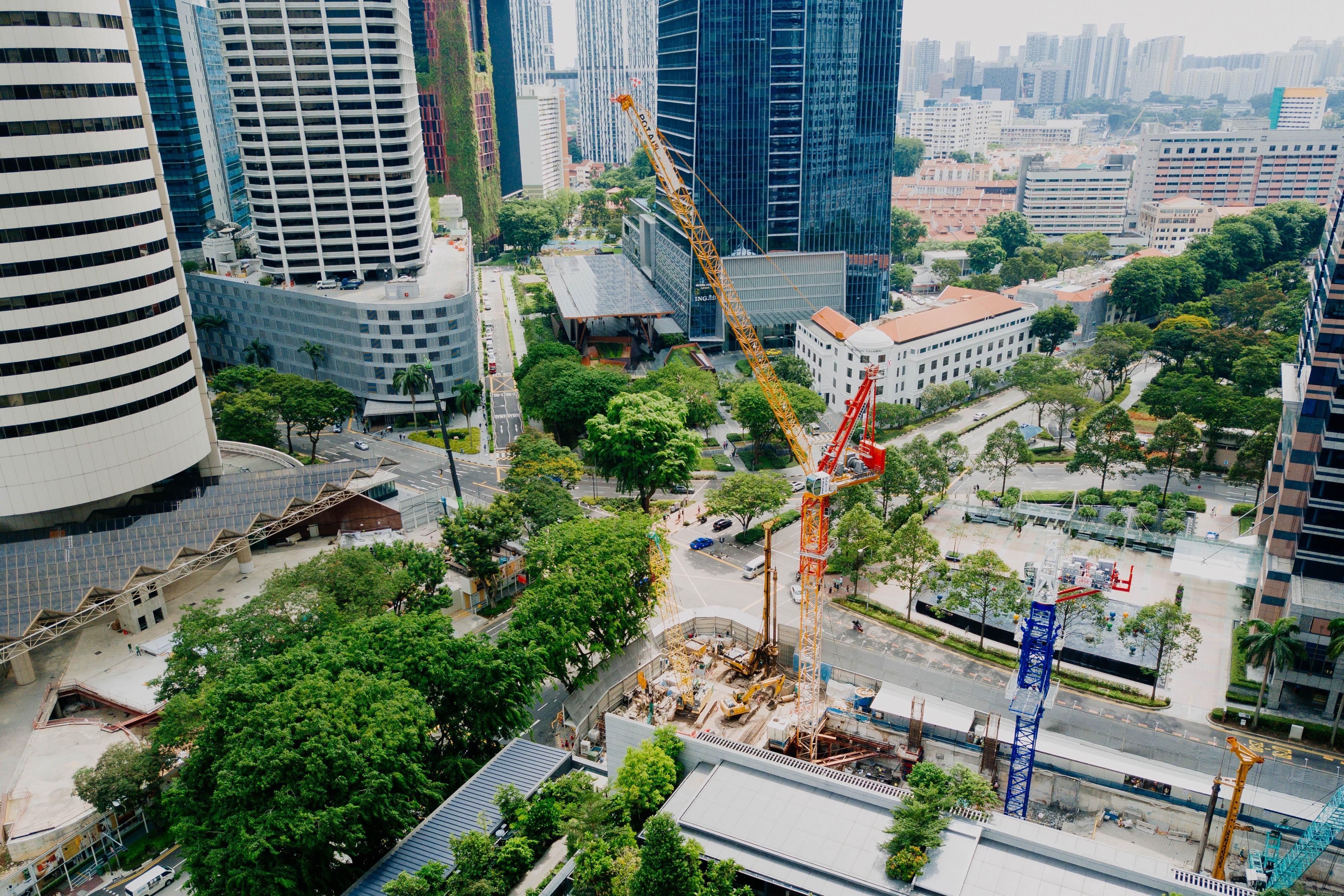 crane beside city buildings