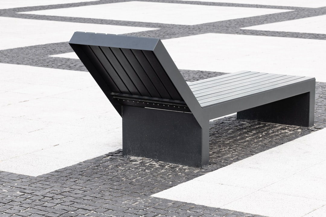 The square is full of benches like this one. I assume it was supposed to look cozy. In my perception, it's rather surreal. That's definitely a place I would like to photograph from a drone (one day ;)