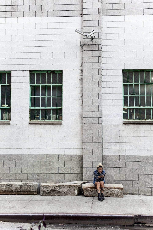 woman sitting on pavement
