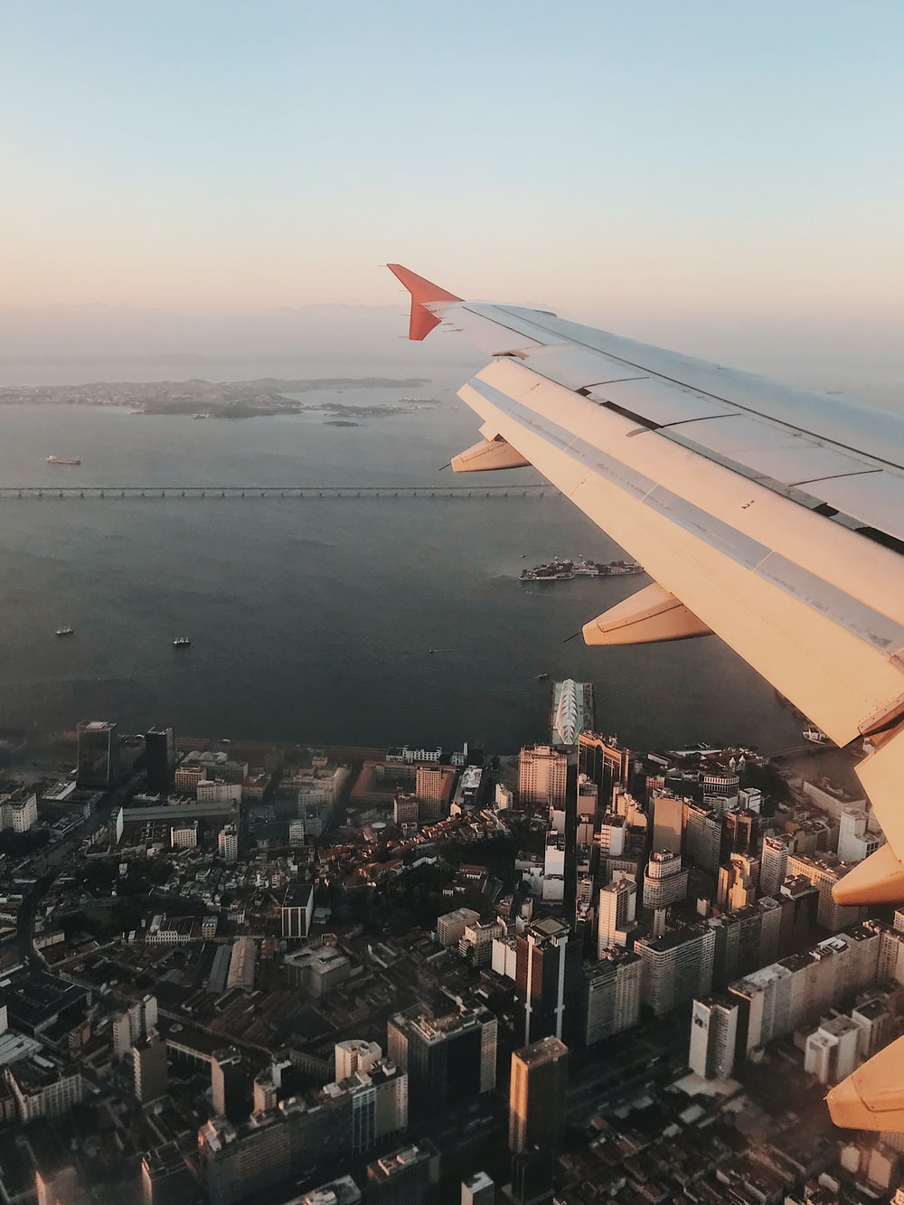 aerial view of plane wings and view of high-rise buildings