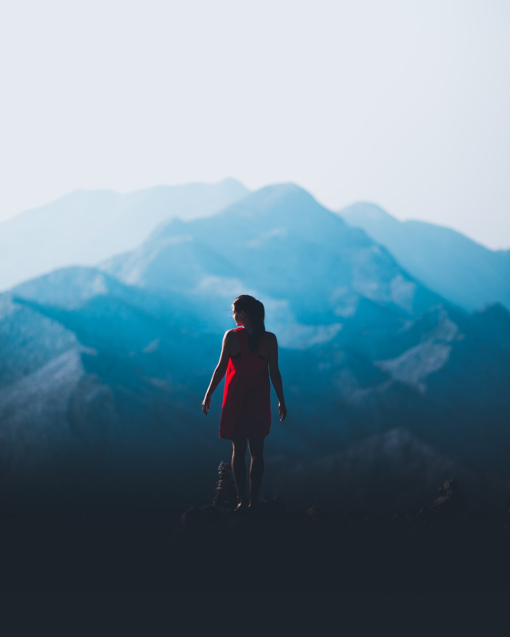 woman standing in front of mountain
