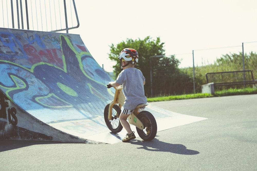 boy riding brown bike