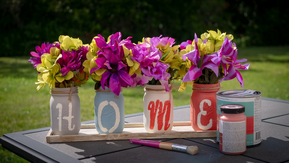 pink and yellow petaled flower lot on desk