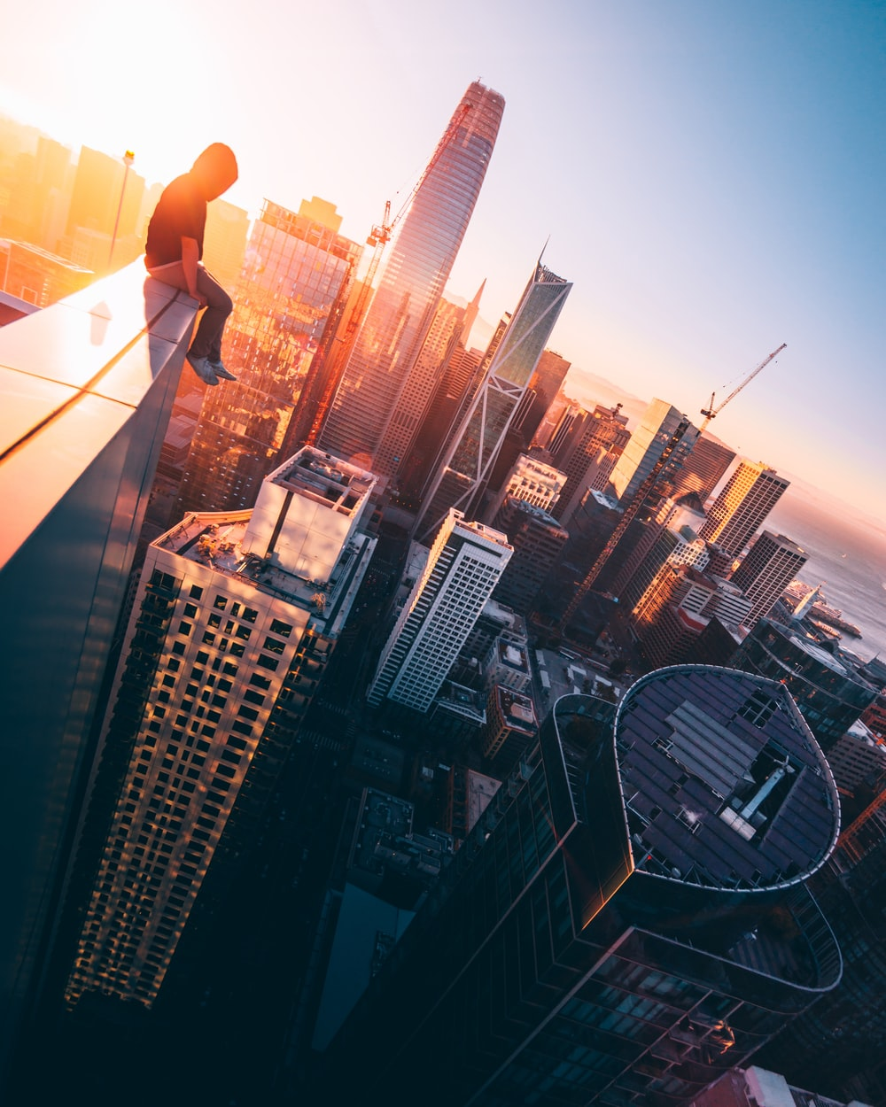 person sitting on top of building during daytime