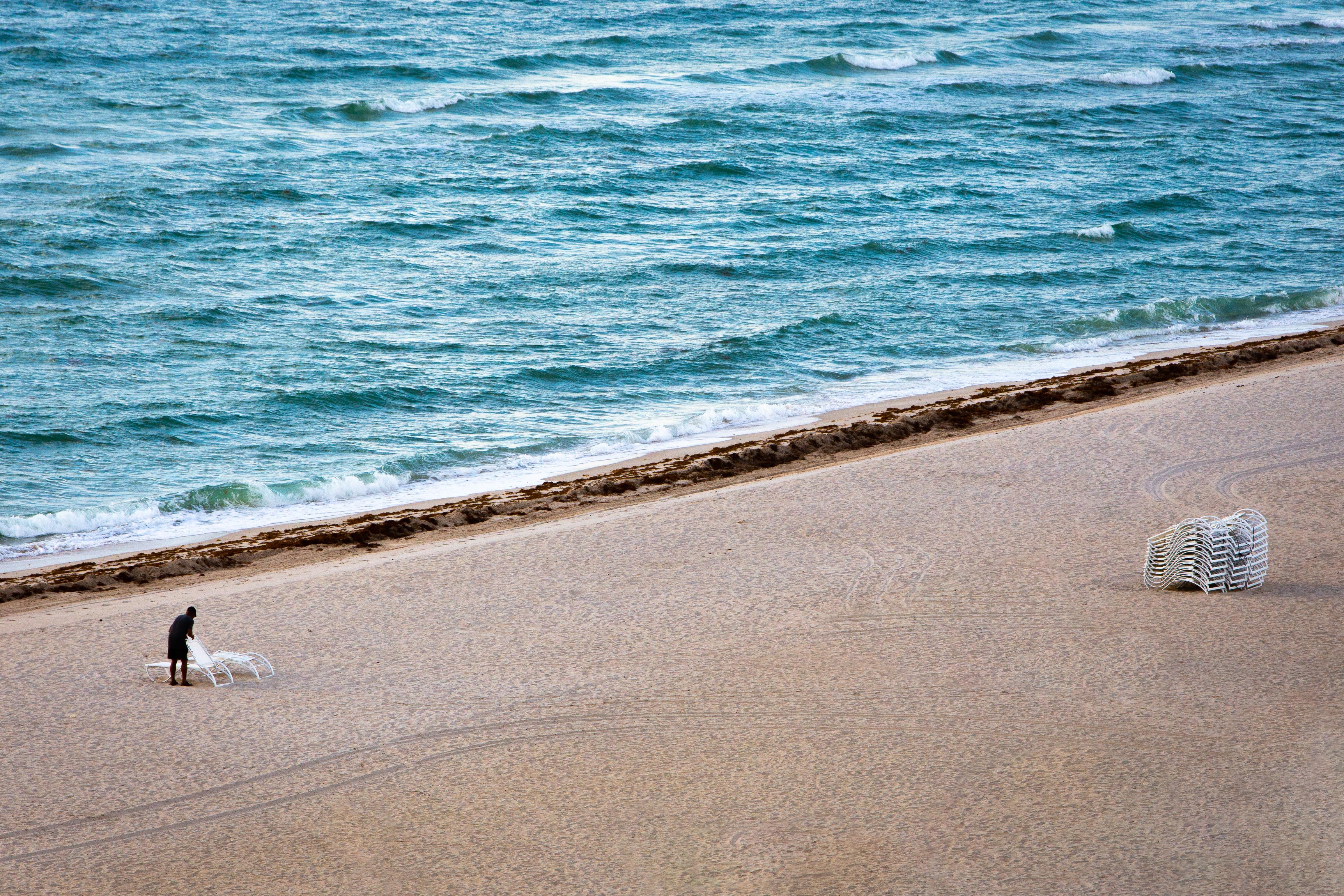 man on white sand
