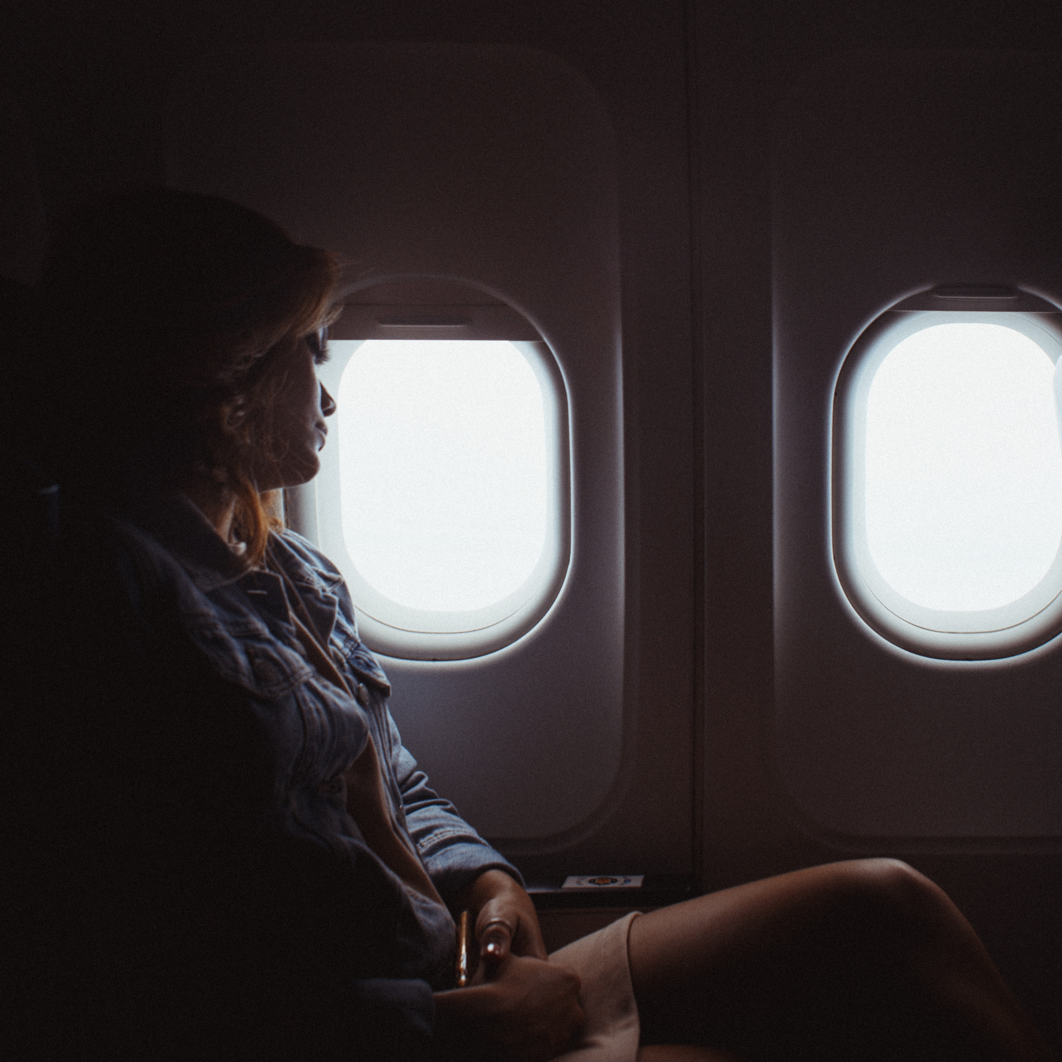 woman sitting inside airliner