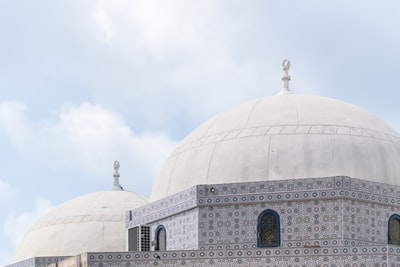 mosque under cloudy sky