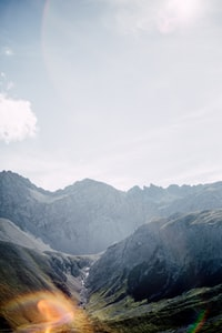 photo of valley near gray concrete mountain