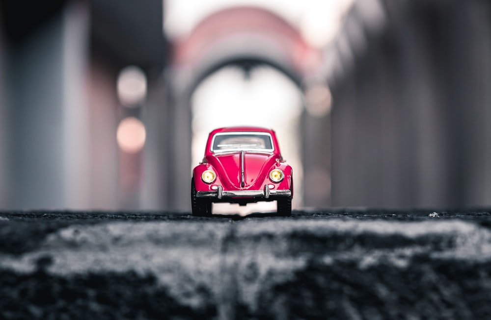 red Volkswagen Beetle die-cast model