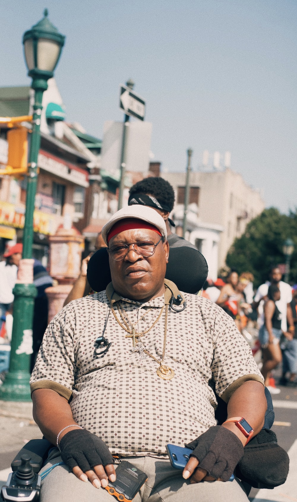 man sitting on motorized wheelchair on street at daytime