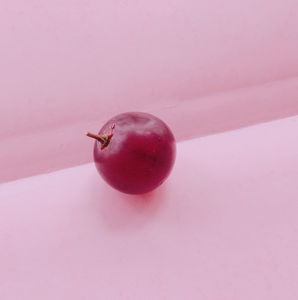 cherry fruit on pink textile