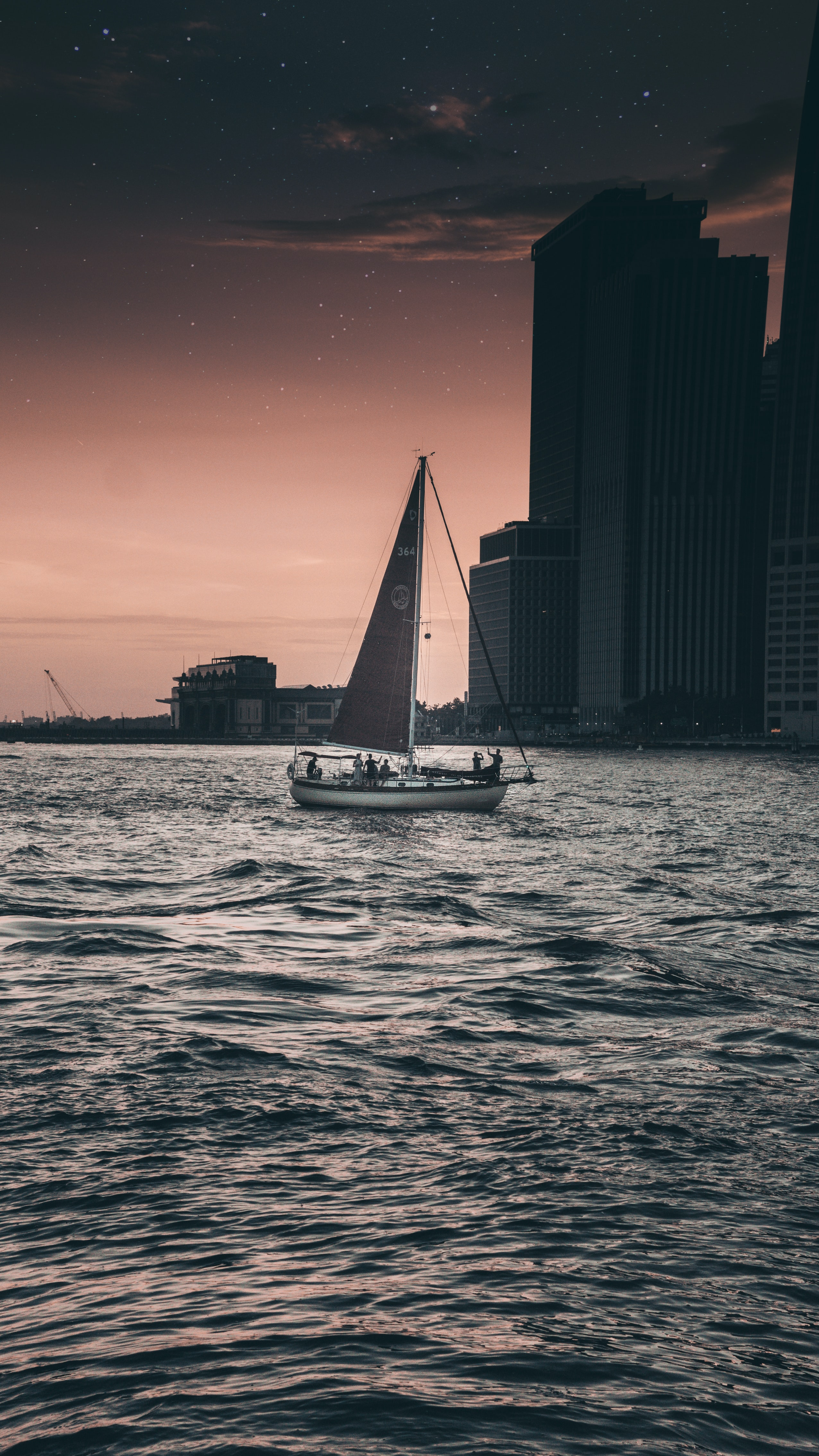 black and gray sailboat on body of water