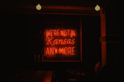 we're not in kansas anymore red neon signage turned on kansas zoom background