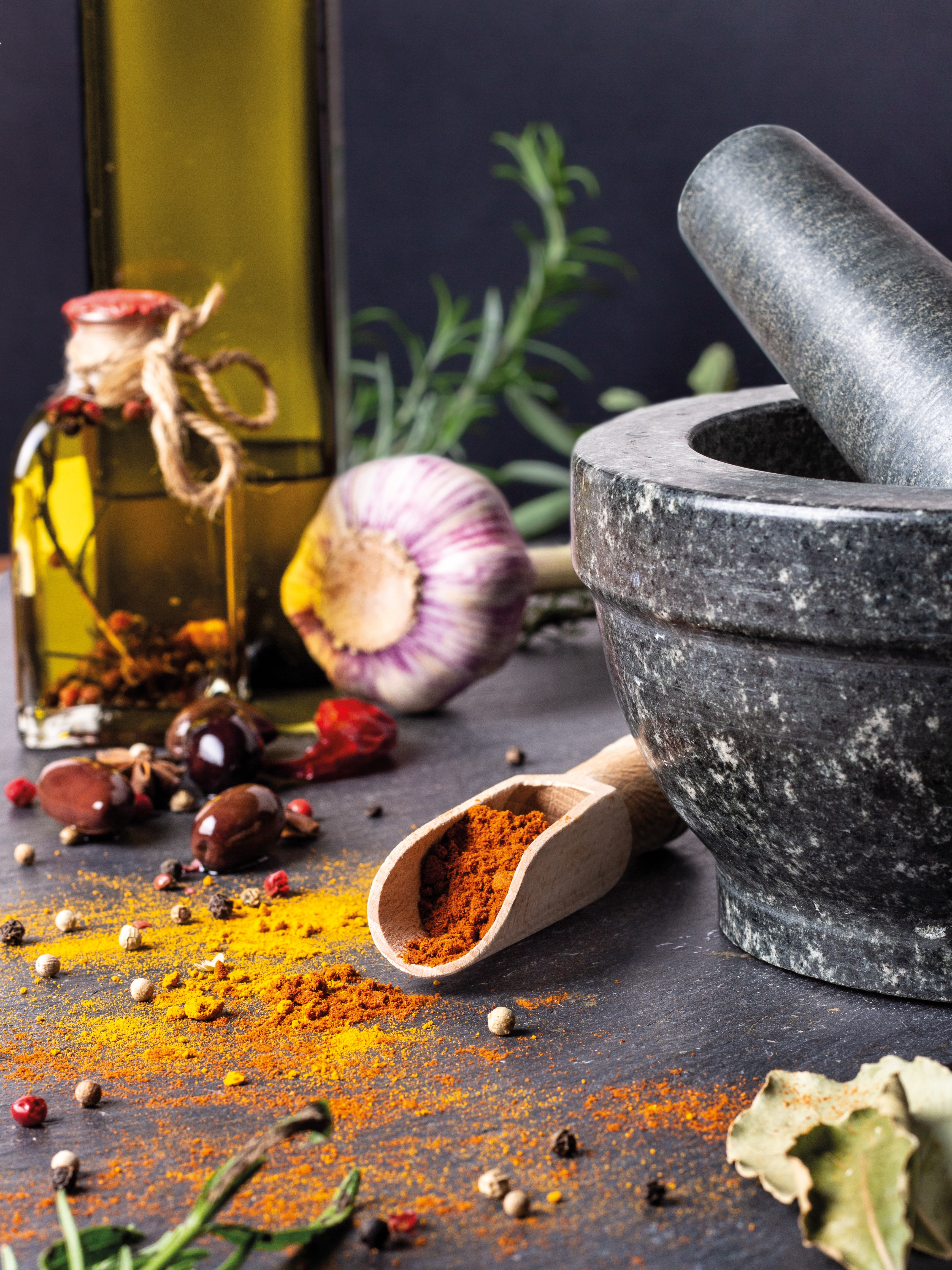 onion and black peppers beside black mortar and pestle