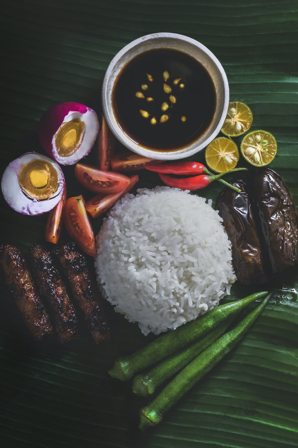 white rice, steamed okra, grilled eggplant, and salted egg