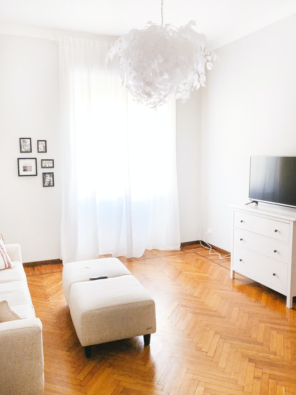 turned-off flat screen television on white dresser