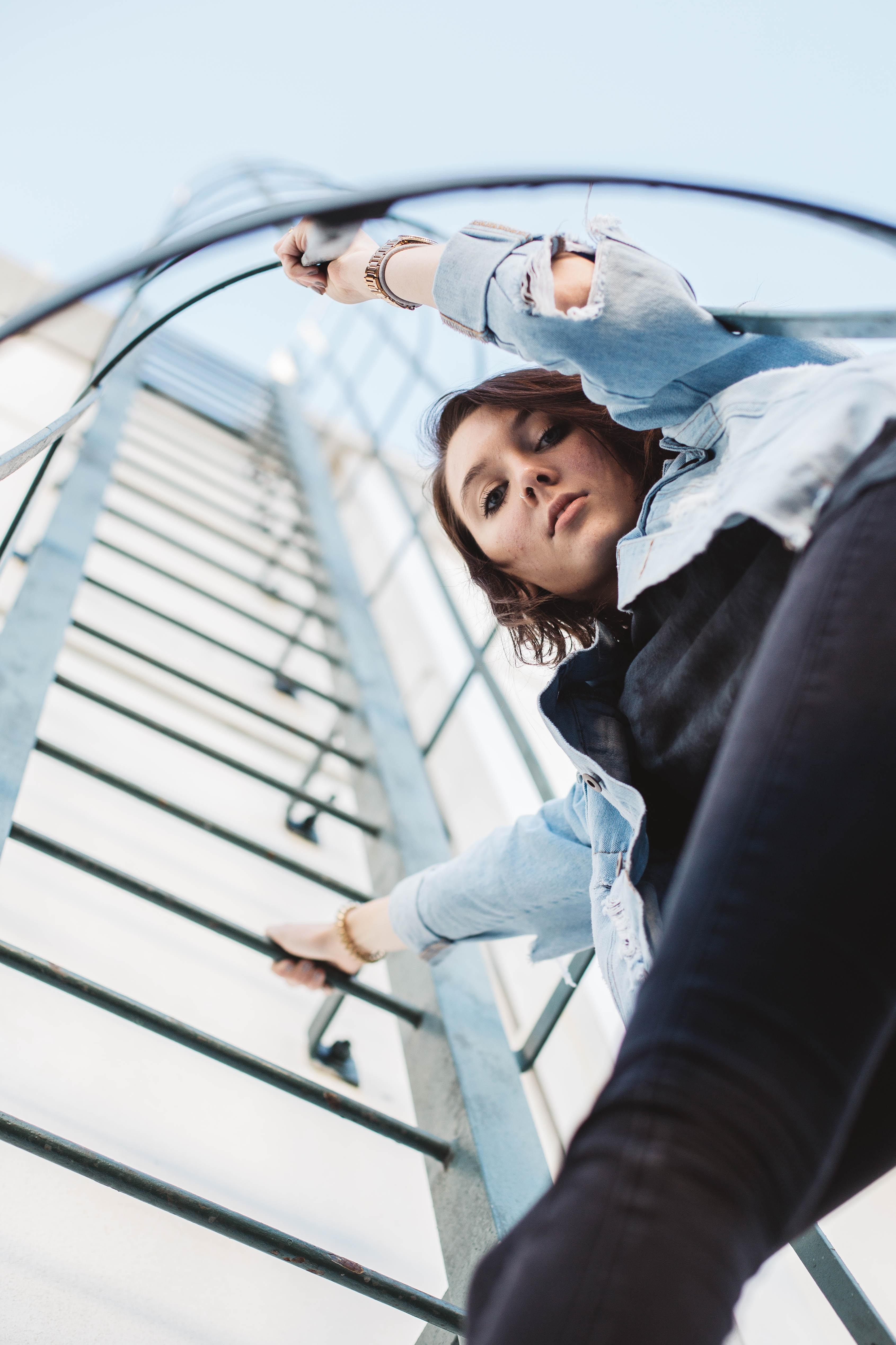 woman climbing on ladder