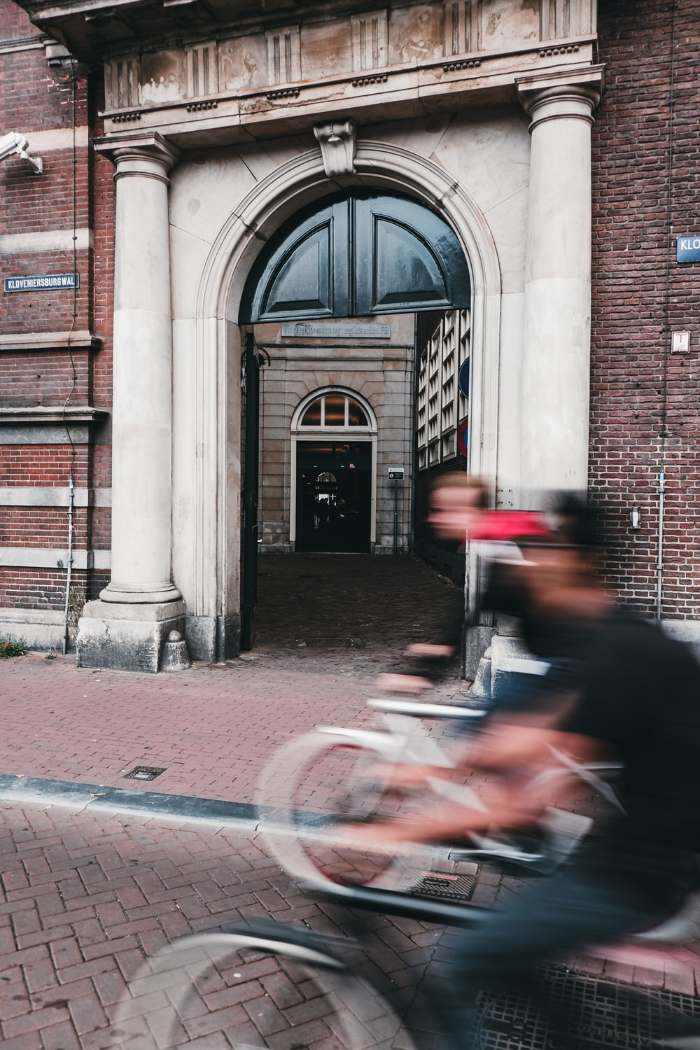 panning photography of two person riding bikes