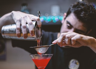 man mixing cocktail drink
