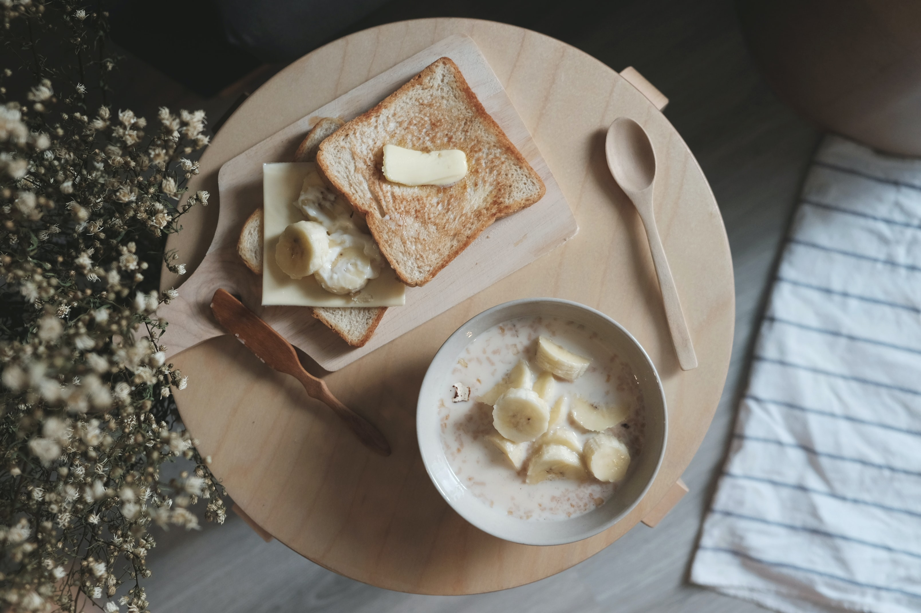 oatmeal with banana and bread with butter on top