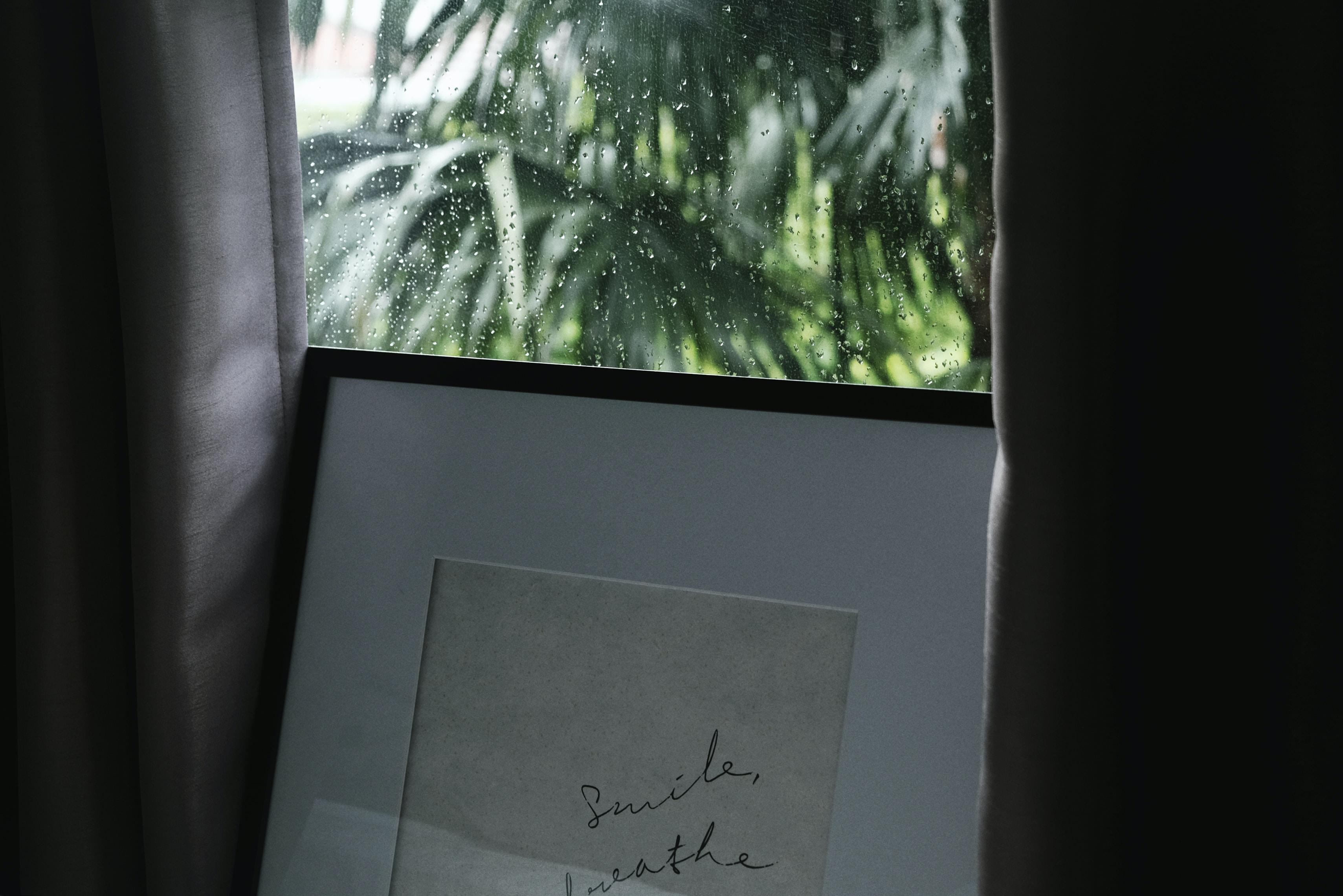 black photo frame on closed window