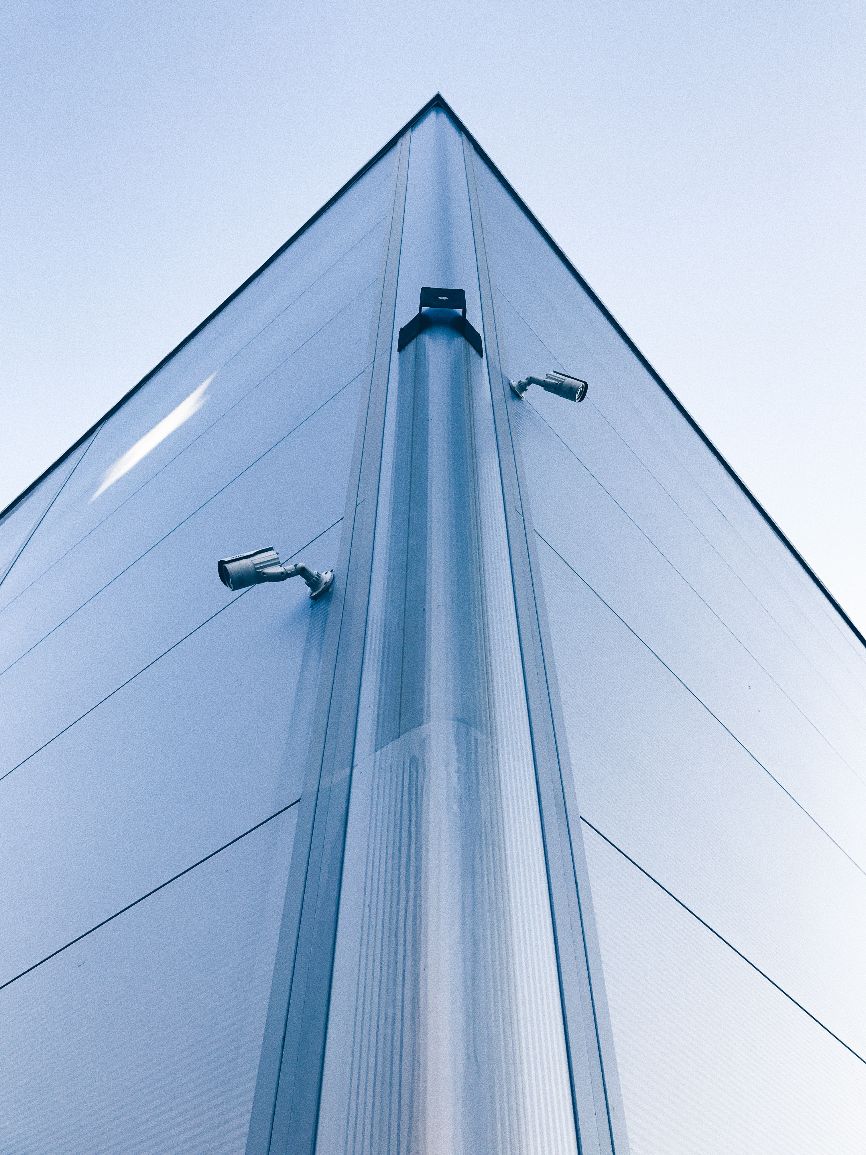 low-angle photo of building with security cameras