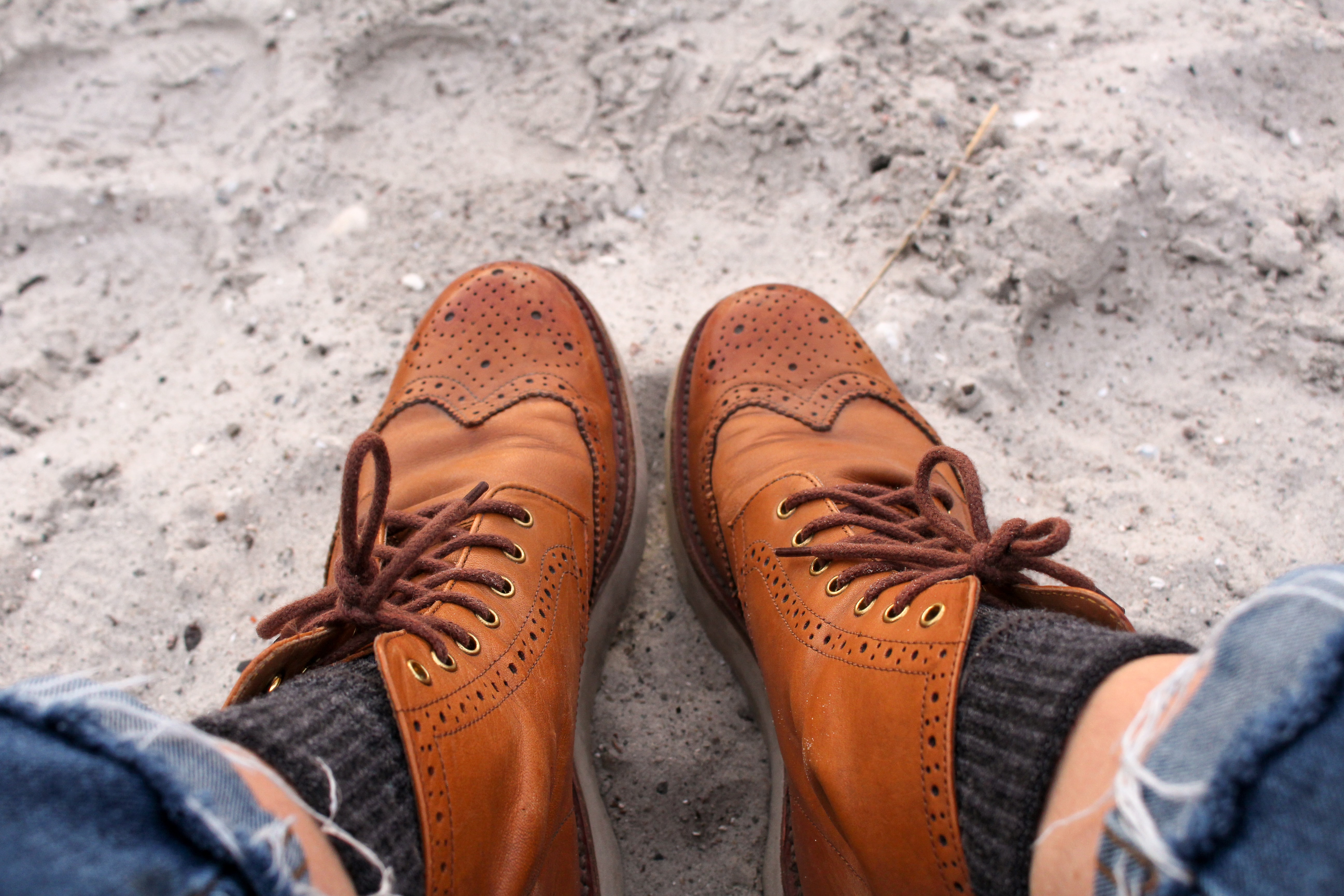 person wearing brown leather loafers