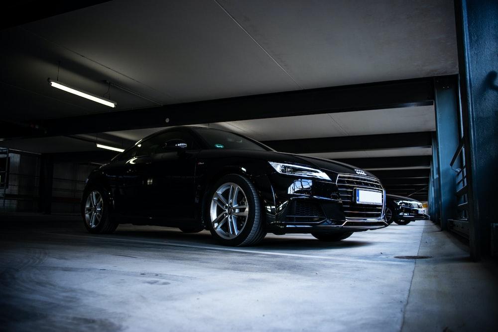 black Audi coupe parked on parking lot