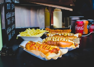 four hotdog sandwiches on desk