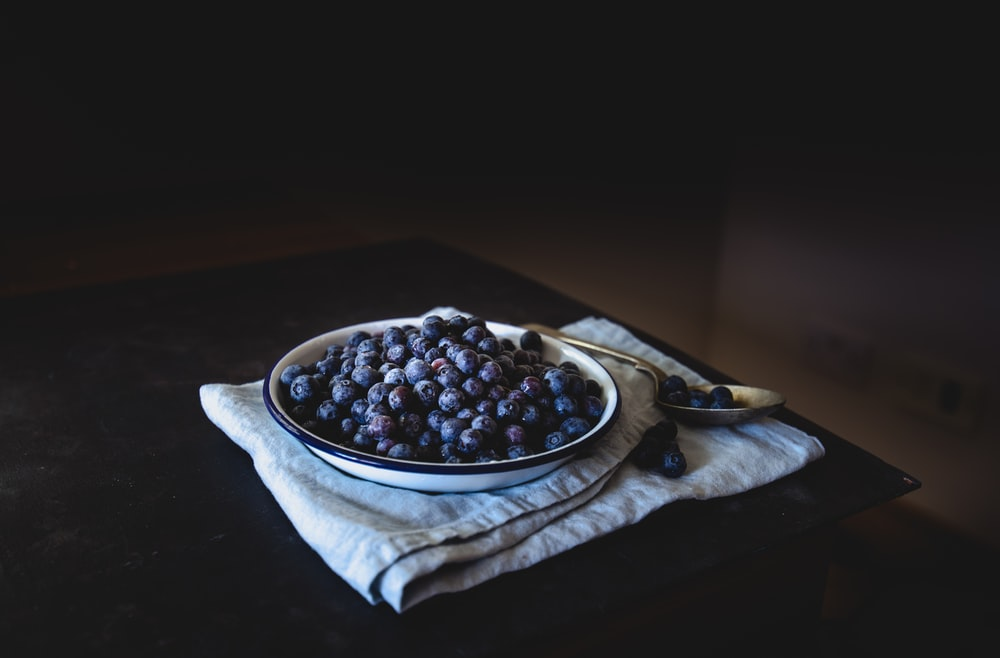 blueberry on white plate