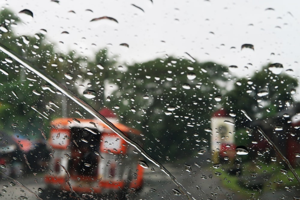 selective focus of vehicle window with water dew