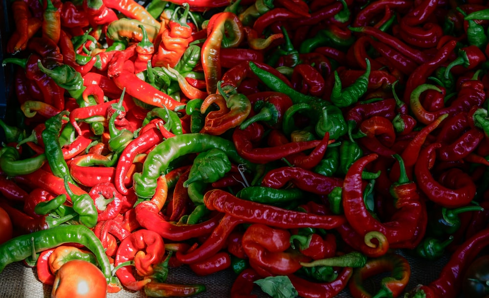 bunch of green and red chilies