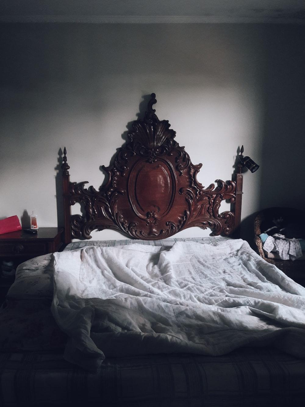 white blanket on bed