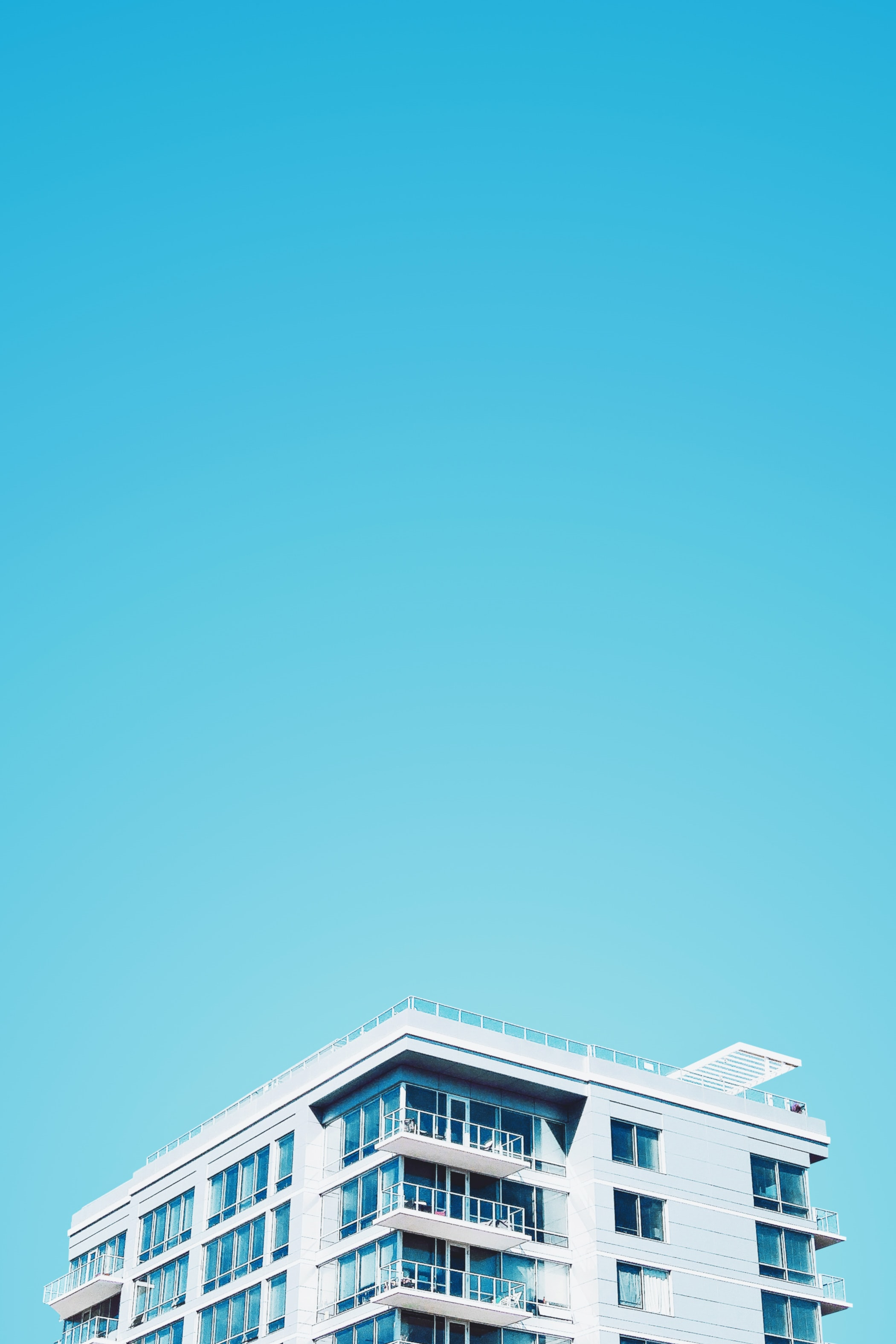 white and blue building under blue sky