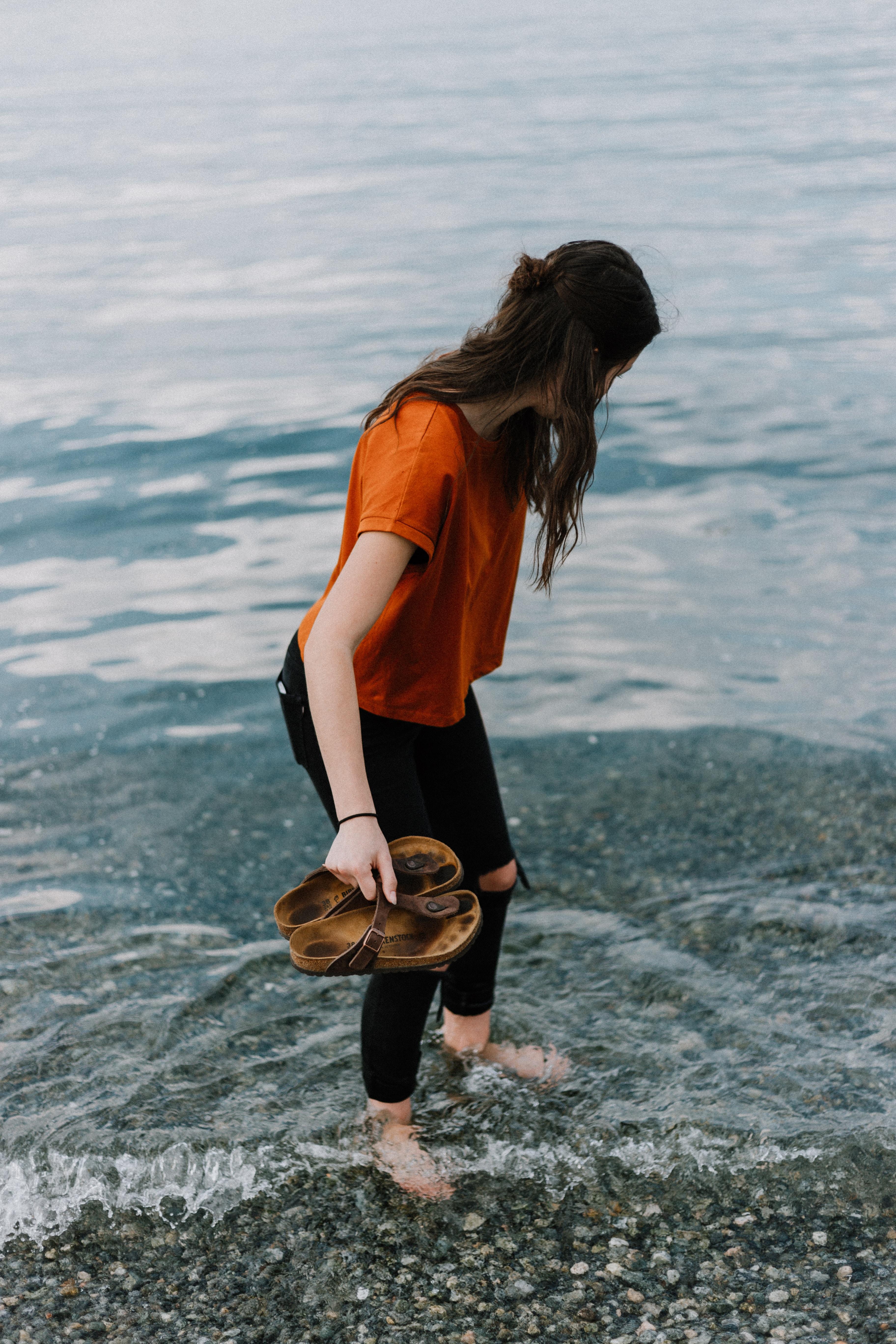 women's orange scoop-neck shirt