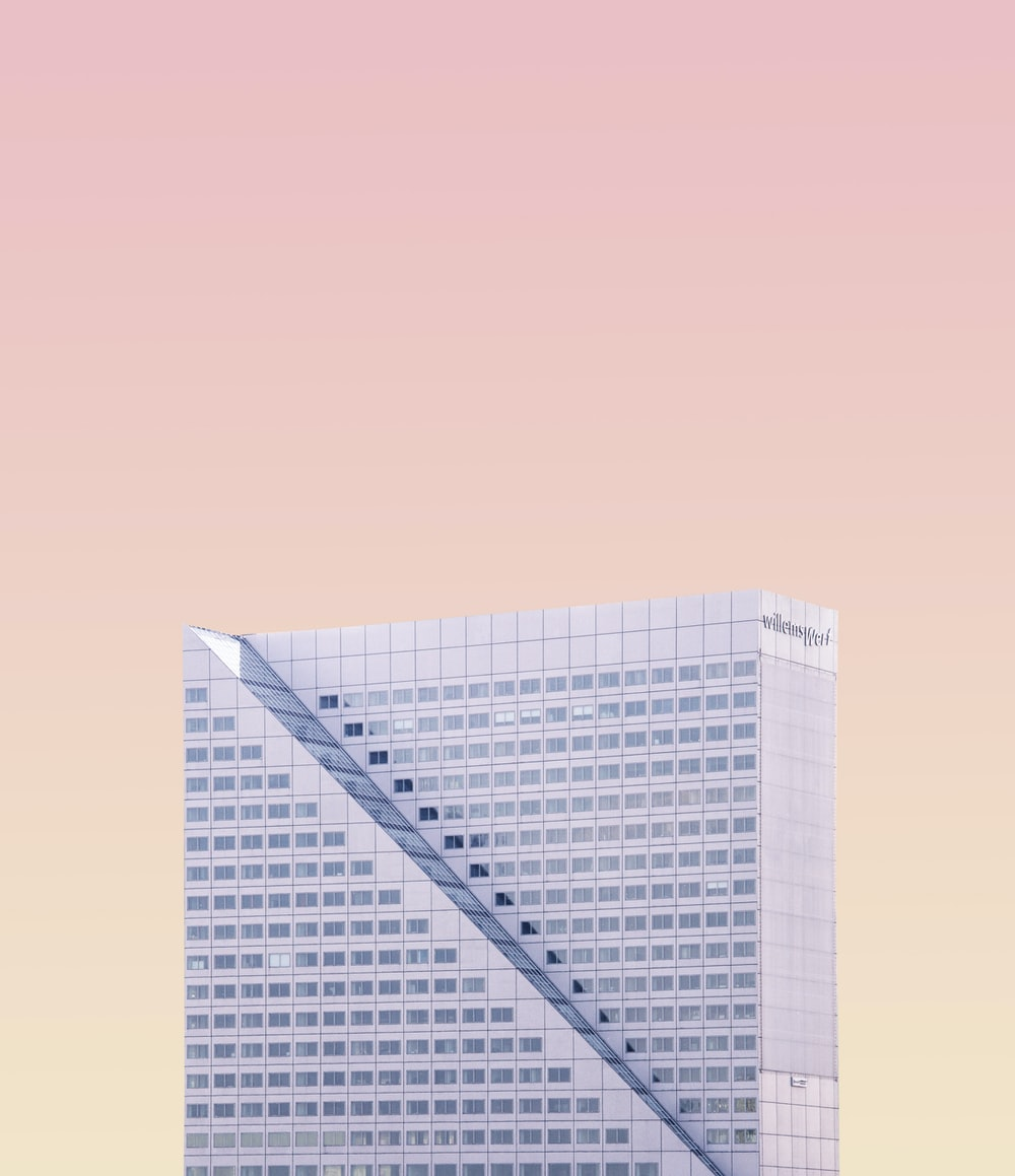high-rise building under pinkish sky